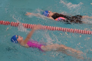Wiltshire Sprints 2017 - Newcomers Amelia Smith and Abigail Garland compete in the backstroke